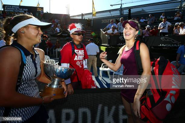 Eugenie Bouchard of Canada talks with a fan with Sofia Kenin of USA after winning the the Women's doubles final match against Taylor Townsend of USA...