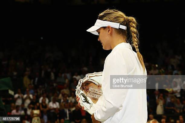 Eugenie Bouchard of Canada walks of dejected holding her runnerup trophy after the Ladies' Singles final match against Petra Kvitova of Czech...