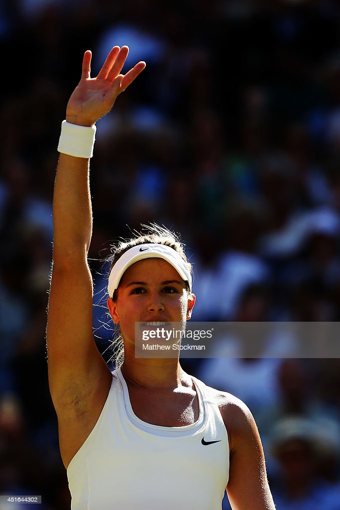 Eugenie Bouchard of Canada waves to the fans as she celebrates after winning her Ladies' Singles semi-final match against Simona Halep of Romania on day ten of the Wimbledon Lawn Tennis Championships at the All England Lawn Tennis and Croquet Club on July 3, 2014 in London, England.
