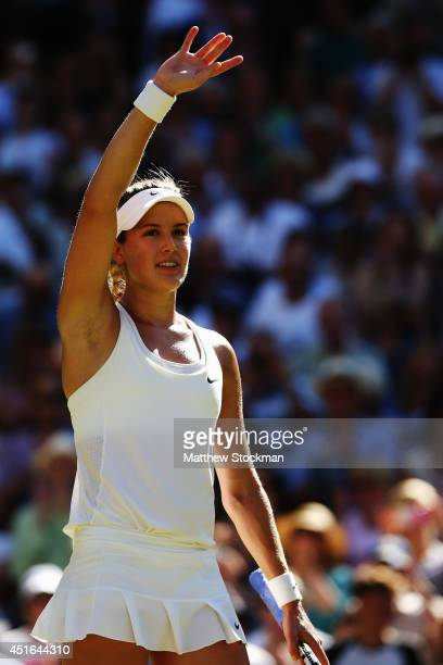 Eugenie Bouchard of Canada waves to the fans as she celebrates after winning her Ladies' Singles semifinal match against Simona Halep of Romania on...