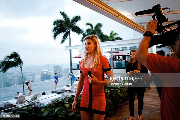 Eugenie Bouchard walks across the MArina Bay Sands Skypark during a session January 27, 2014 in Singapore.