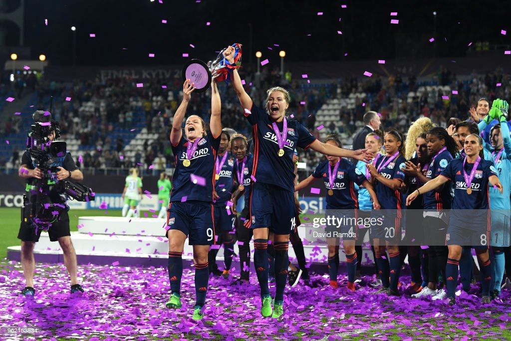 Eugenie Le Sommer and Ada Hegerberg of Lyon celebrate with the trophy during the UEFA Womens Champions League Final between VfL Wolfsburg and Olympique Lyonnais on May 24, 2018 in Kiev, Ukraine.