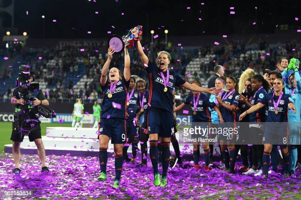 Eugenie Le Sommer and Ada Hegerberg of Lyon celebrate with the trophy during the UEFA Womens Champions League Final between VfL Wolfsburg and...