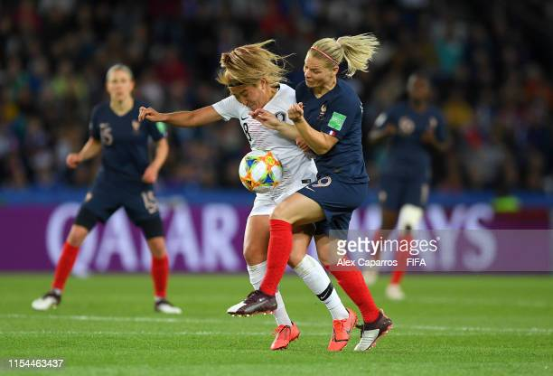 Eugenie Le Sommer of France battles for possession with Sohyun Cho of Korea Republic during the 2019 FIFA Women's World Cup France group A match...