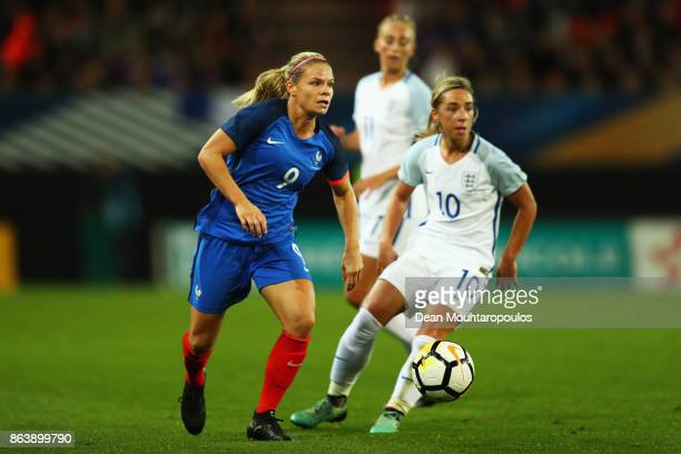 Eugenie Le Sommer of France battles for the ball with Jordan Nobbs of England during the International friendly match between France and England held...