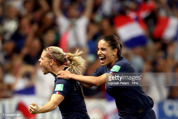 Eugenie Le Sommer of France celebrates with teammate Amel Majri after scoring her team's second goal during the 2019 FIFA Women's World Cup France...