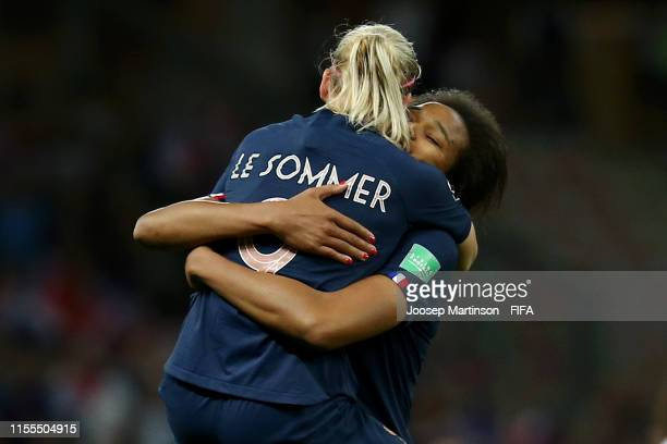 Eugenie Le Sommer of France celebrates with teammate Wendie Renard after scoring her team's second goal during the 2019 FIFA Women's World Cup France...