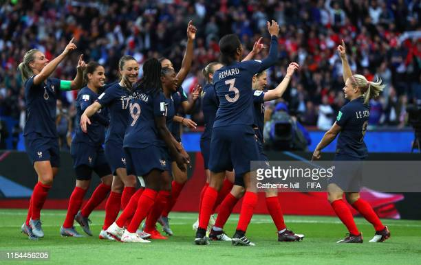 Eugenie Le Sommer of France celebrates with teammates after scoring her team's first goal during the 2019 FIFA Women's World Cup France group A match...