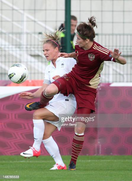 Eugenie Le Sommer of France fights for the ball with Natalia Pertseva of Russia during the women's international friendly match between France and...