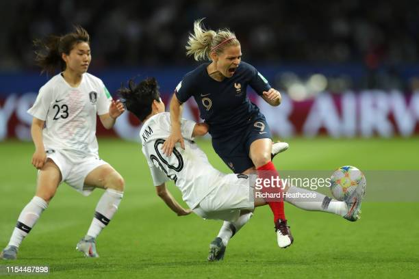 Eugenie Le Sommer of France is challenged by Hyeri Kim of Korea Republic during the 2019 FIFA Women's World Cup France group A match between France...