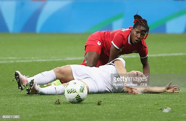 Eugenie le Sommer of France is challenged by Kadeisha Buchanan of Canada during the Women's Football Quarter Final match between Canada and France on...
