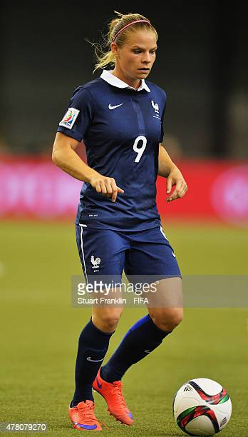 Eugenie Le Sommer of France is challenged by of Korea during the FIFA Womens's World Cup round of 16 match between France and Korea at Olympic...