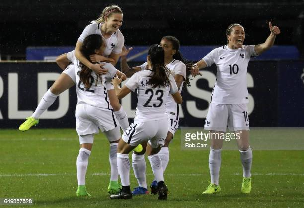 Eugenie Le Sommer of France jumps into the arms of teammates after scoring the second goal in the first half of their match against the United States...