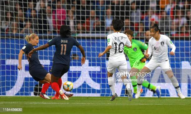 Eugenie Le Sommer of France scores her team's first goal during the 2019 FIFA Women's World Cup France group A match between France and Korea...
