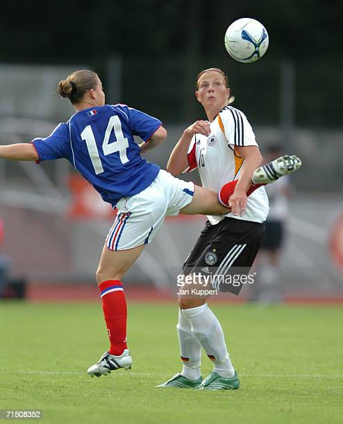Eugenie Le Sommer of France tackles Josephine Schlanke of Germany during the Women's U19 Europen Championship match between Germany and France at...