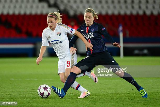 Eugenie Le Sommer of Lyon and Lisa Dahlkvist of PSG during the Uefa Women's Champions League match semifinal second leg between Paris Saint Germain...