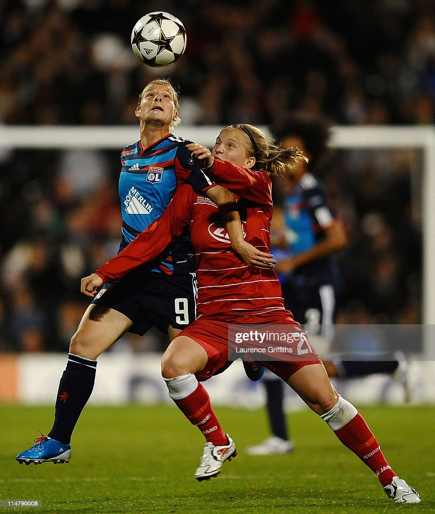Eugenie Le Sommer of Lyon battles with Tabea Kemme of Turbine Potsdam during the UEFA Women's Champions League Final between Lyon and Turbine Potsdam at Craven Cottage on May 26, 2011 in London, England.