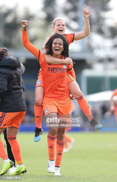 Eugenie Le Sommer of Lyon jumps on the back of captain Wendie Renard as they celebrate getting through to the final during the Women UEFA Champions...