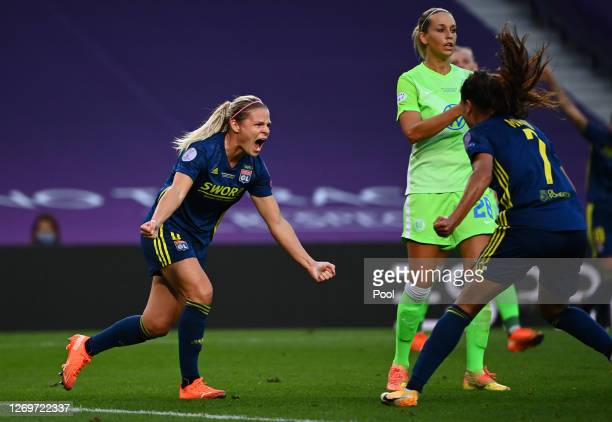 Eugenie Le Sommer of Olympique Lyon celebrates with teammate Amel Majri after scoring her team's first goal during the UEFA Women's Champions League...
