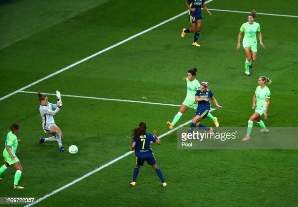 Eugenie Le Sommer of Olympique Lyon scores her team's first goal during the UEFA Women's Champions League Final between VfL Wolfsburg Women's and...