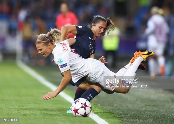 Eugenie Le Sommer of Olympique Lyonnais is challenged by Eve Perisset of Paris SaintGermain Feminines during the UEFA Women's Champions League Final...