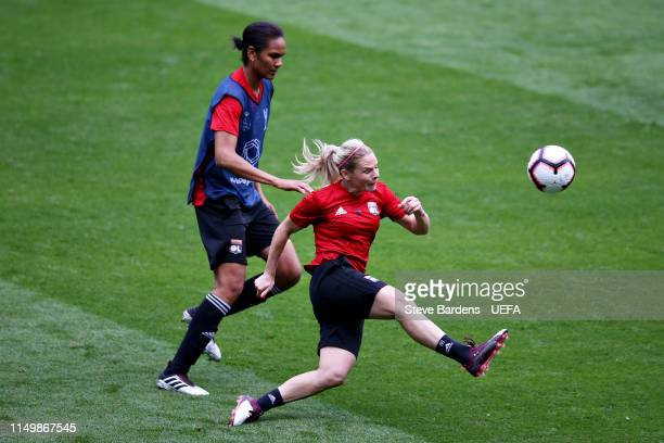 Eugenie Le Sommer of Olympique Lyonnais Women and teammate Wendie Renard take part in a training session during previews ahead of the UEFA Women's...