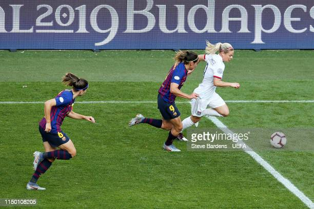 Eugenie Le Sommer of Olympique Lyonnais Women dribbles the ball away from Barbara Latorre of FC Barcelona Women during the UEFA Women's Champions...