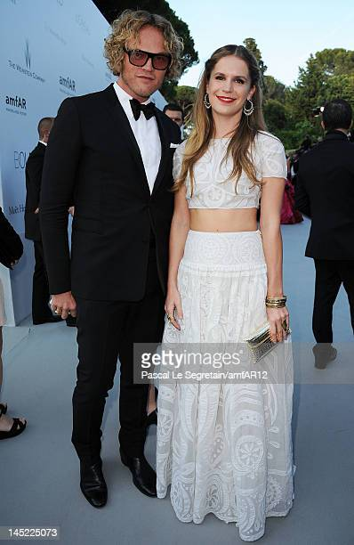 Eugenie Niarchos and artistic director at Emilio Pucci Peter Dundas arrive at the 2012 amfAR's Cinema Against AIDS during the 65th Annual Cannes Film...