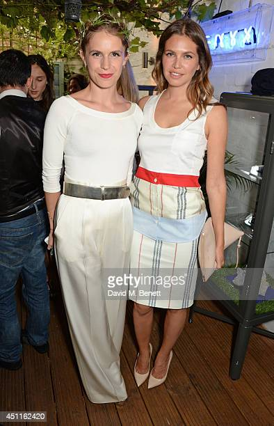 Eugenie Niarchos and Dasha Zhukova attend Mazi's Summer Party with guest of honor Eugenie Niarchos Venyx World on June 24 2014 in London England