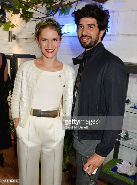 Eugenie Niarchos and Fernando Jorge attend Mazi's Summer Party with guest of honor Eugenie Niarchos Venyx World on June 24 2014 in London England