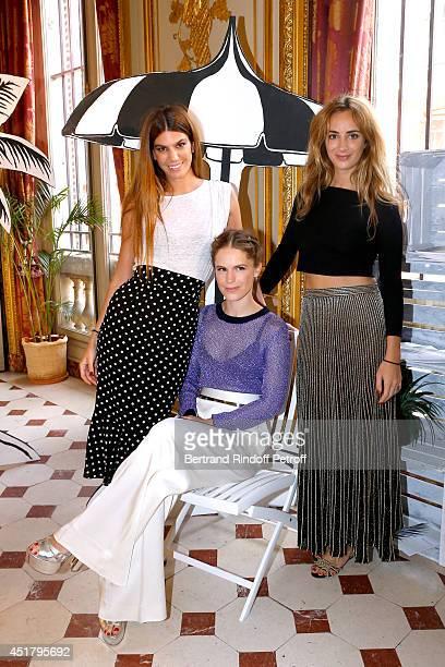 Eugenie Niarchos standing between Fashion designers Bianca Brandolini D'adda and Alexia Niedzielski attend the Osklen Praia show as part of Paris...