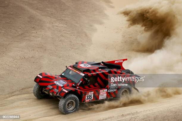 Eugenio Amos of Italy and Two Wheels Drive drives with codriver Sebastien Delaunay of France in the Ford Buggy 2WD in the Classe T13 2 Roues Motrices...