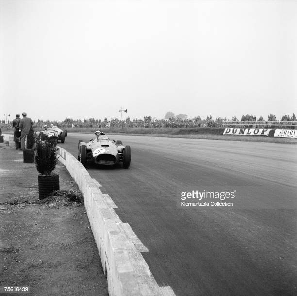 Eugenio Castellotti driving the FerrariLancia early in the British Grand Prix at Silverstone 14th July 1956 He later came in and gave this car over...