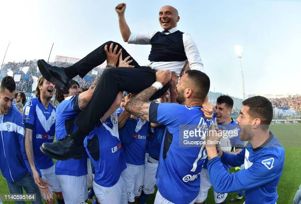 Eugenio Corini head coach of Brescia Calcio celebrates with his players winning the Serie B championship after the Serie B match between Brescia...