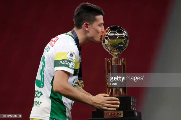 Eugenio Isnaldo of Defensa y Justicia kisses the trophy after winning a match between Palmeiras and Defensa y Justicia as part of the second leg of...