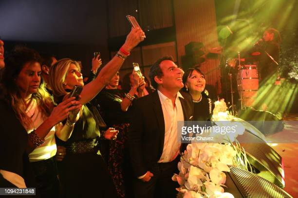 Eugenio Lopez enjpys the show during the amfAR gala dinner at the house of collector and museum patron Eugenio López on February 5 2019 in Mexico...