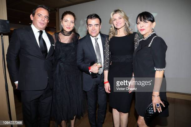 Eugenio Lopez Guest Tono Mauri Carla Aleman and Stella Provas pose during the amfAR gala dinner at the house of collector and museum patron Eugenio...