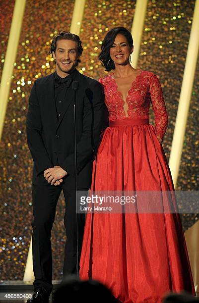 Eugenio Siller and Carmen Dominicci present onstage during the 2014 Billboard Latin Music Awards at Bank United Center on April 24 2014 in Miami...