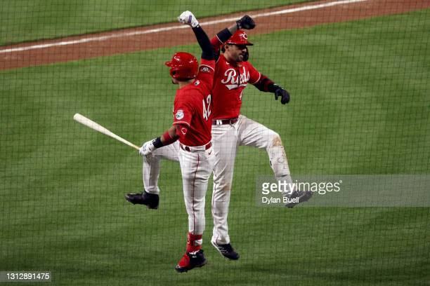 Eugenio Suarez and Nick Castellanos of the Cincinnati Reds celebrate after Castellanos hit a home run in the sixth inning against the Cleveland...