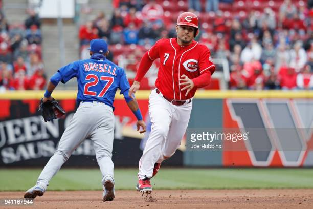 Eugenio Suarez of the Cincinnati Reds advances to third base after a double by Tucker Barnhart in the sixth inning of the game against the Chicago...