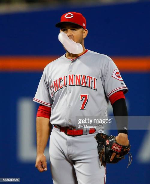 Eugenio Suarez of the Cincinnati Reds blows a bubble during the first inning against the New York Mets at Citi Field on September 8 2017 in the...