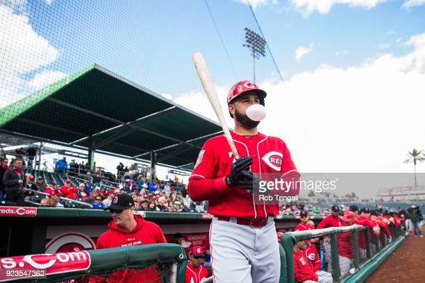 Eugenio Suarez of the Cincinnati Reds blows a bubble on his way to the on deck circle against the Cleveland Indians during a Spring Training Game at...