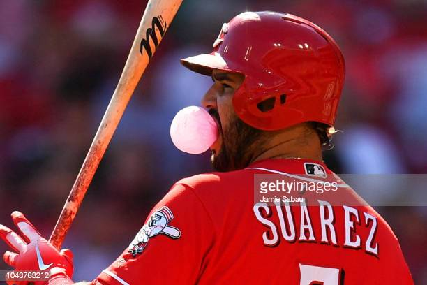 Eugenio Suarez of the Cincinnati Reds blows a bubble while batting in the first inning against the Pittsburgh Pirates at Great American Ball Park on...