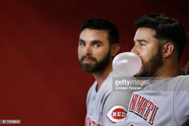 Eugenio Suarez of the Cincinnati Reds blows a gum bubble alongside Jose Peraza during the MLB game against the Arizona Diamondbacks at Chase Field on...