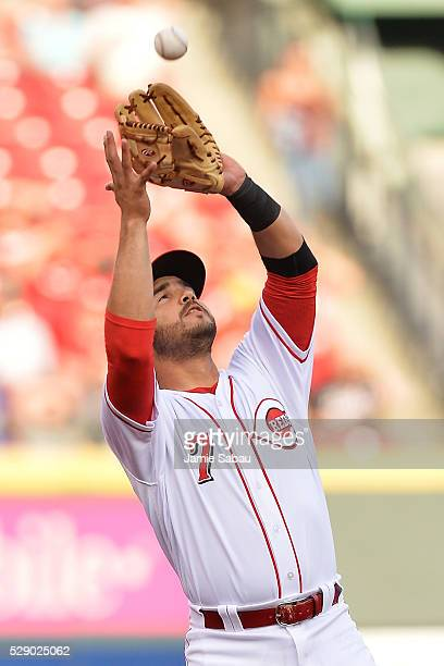 Eugenio Suarez of the Cincinnati Reds catches a pop fly for the first out against the Milwaukee Brewers at Great American Ball Park on May 7 2016 in...