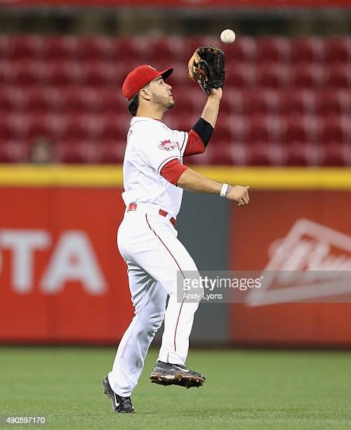 Eugenio Suarez of the Cincinnati Reds catches the ball during the game against the Chicago Cubs at Great American Ball Park on September 29 2015 in...