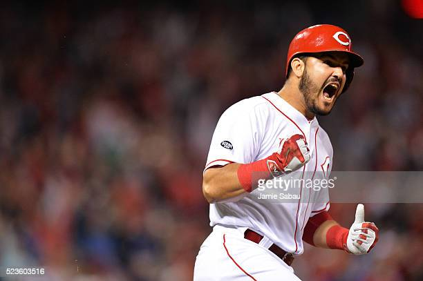 Eugenio Suarez of the Cincinnati Reds celebrates as he runs the bases after hitting a threerun home run in the sixth inning against the Chicago Cubs...