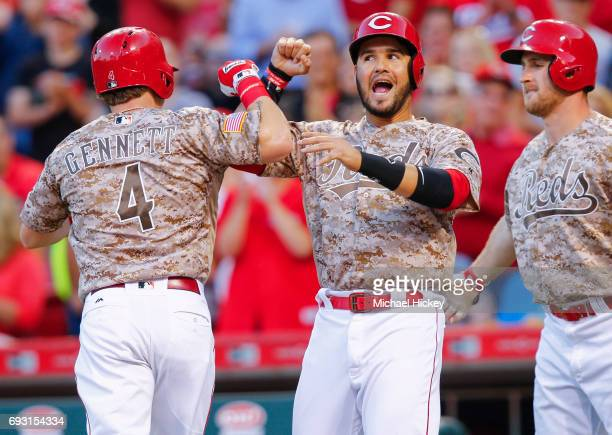 Eugenio Suarez of the Cincinnati Reds congratulates Scooter Gennett of the Cincinnati Reds after hitting his second home run of the night in the...