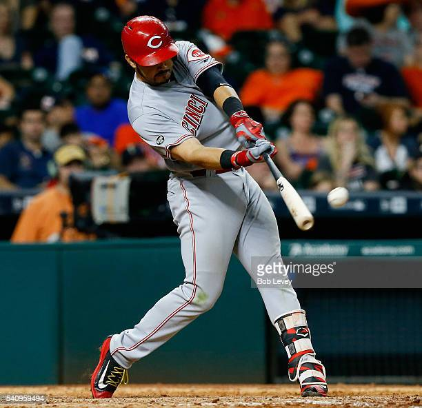 Eugenio Suarez of the Cincinnati Reds doubles in the eleventh inning against the Houston Astros at Minute Maid Park on June 17 2016 in Houston Texas