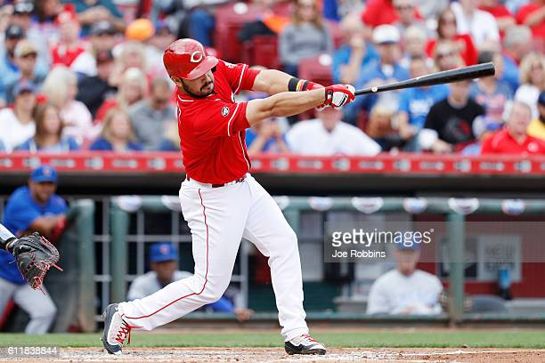 Eugenio Suarez of the Cincinnati Reds drives in a run with a sacrifice fly in the third inning against the Chicago Cubs at Great American Ball Park...